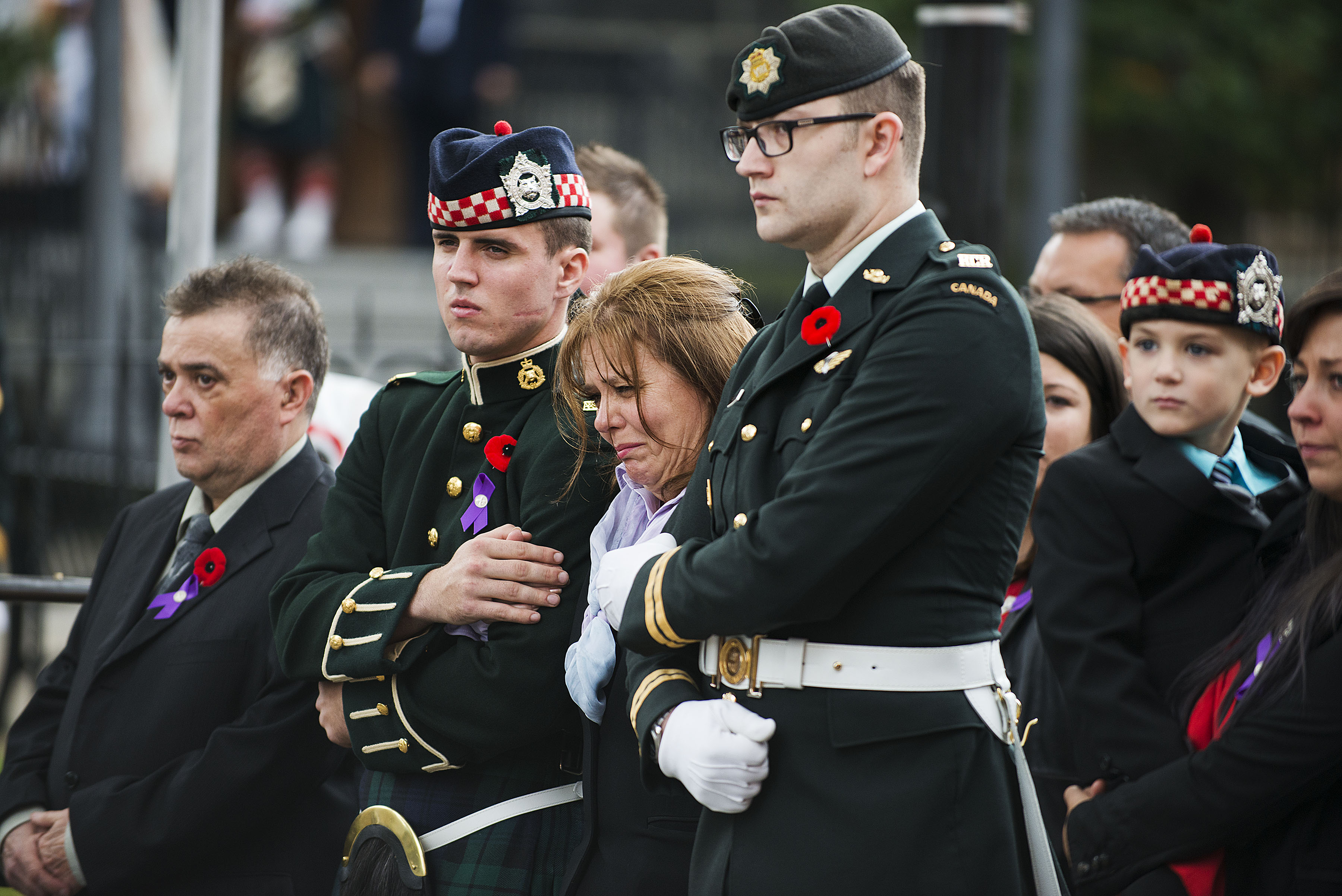 Kathy Cirillo (3rd L),  the wife of Cpl. Nathan Cirillo Laureen Cirillo, mourns as her son Marcus Cirillo (2nd R), looks on during Nathan Cirillo's funeral at the Christ's Church Cathedral on October 28, 2014 in Hamilton, Ontario, Canada. Cirillo was shot and killed while on duty at Parliament Hill in Ottawa by Michael Zehaf-Bibeau on October 22.  (Photo by Aaron Vincent Elkaim/Getty Images)