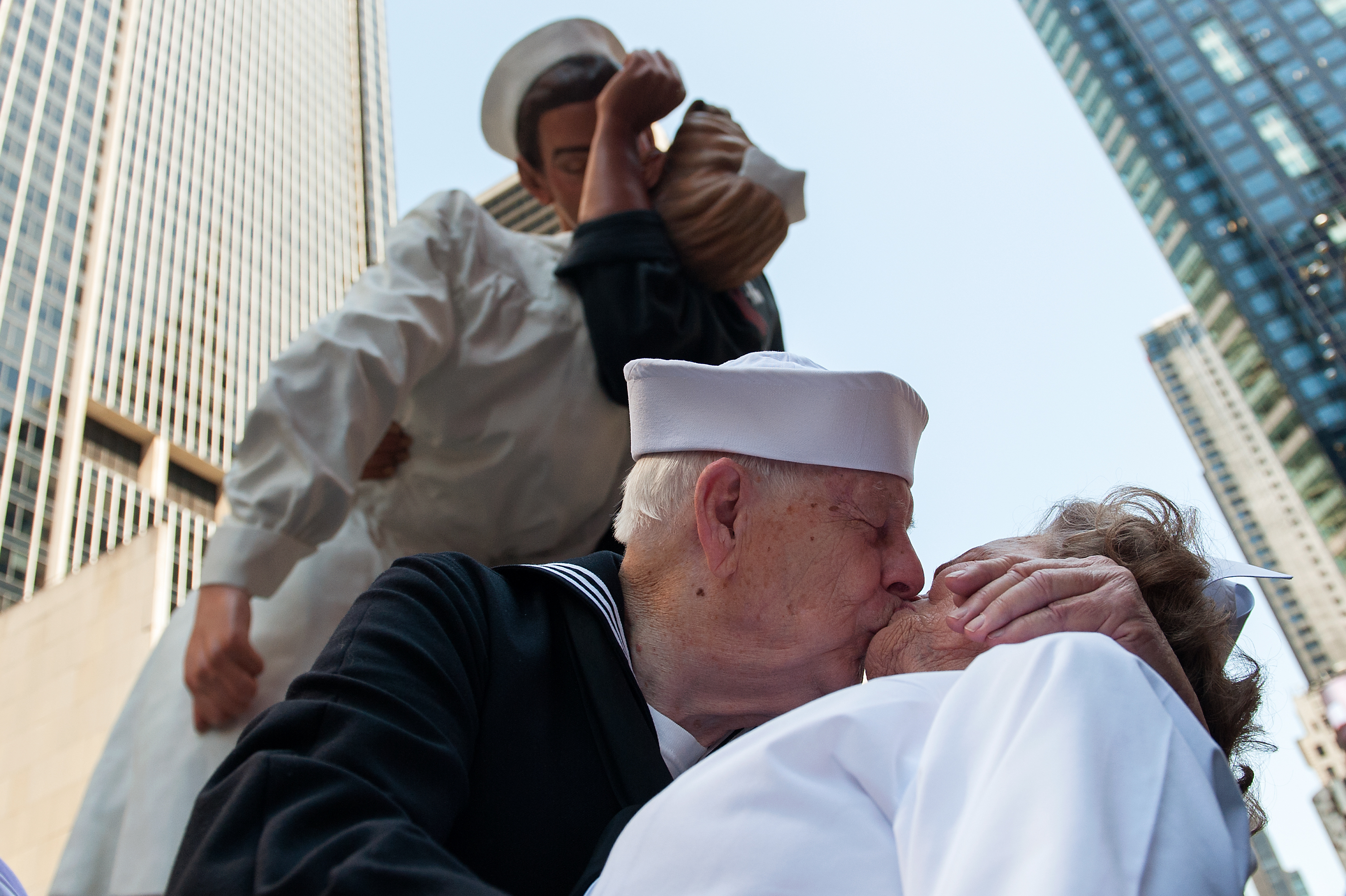 NEW YORK, NY - AUGUST 14: World War II Veterans Ray and Ellie Williams recreate the iconic Alfred Eisenstaedt photograph in Times Square on August 14, 2015 in New York City. The Williams, Navy veterans also celebrating their 70th wedding anniversary, recreated the kiss as part of a ceremony remembering the 70th anniversary of Victory in Japan Day.  (Photo by Bryan Thomas/Getty Images)