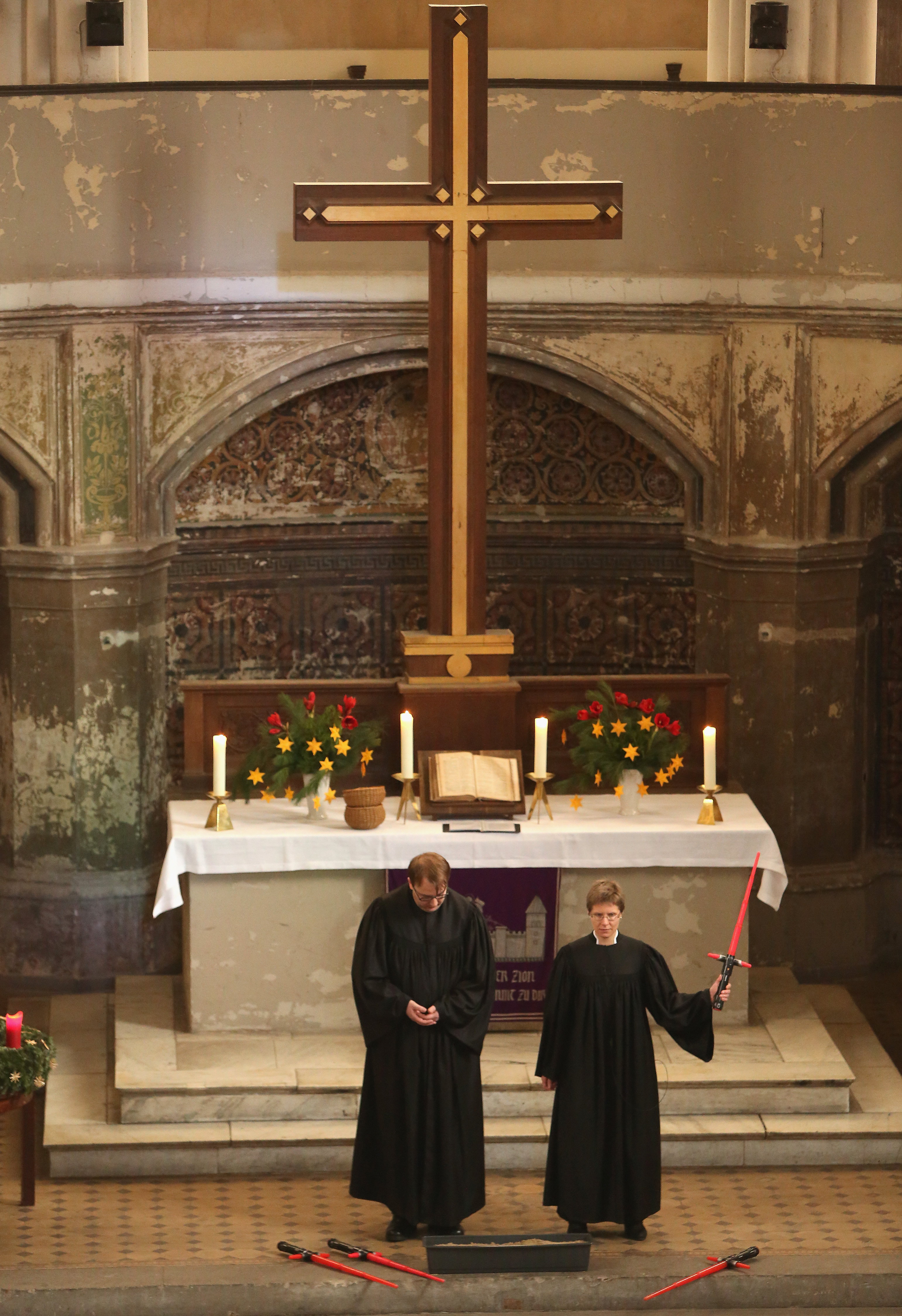 BERLIN, GERMANY - DECEMBER 20:  Vicars Lucas Ludewig (L) and Ulrike Garve hold a church service centered around the 1983 film 'Star Wars Episode VI: Return of the Jedi' at the Zionskirche (Zion Church) on December 20, 2015 in Berlin, Germany. The latest Star Wars film, 'Star Wars Episode VII: The Force Awakens,' was released in the country two days earlier, and local priests used the opportunity to tie Biblical parallels concerning good and evil to the movie, while using the original film's score by John Williams as organ accompaniment, along with video clips.  (Photo by Adam Berry/Getty Images)